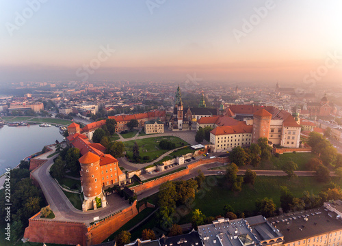 obraz PCV Aerial view Royal Wawel Castle and Gothic Cathedral in Cracow, Poland, with Renaissance Sigismund Chapel with golden dome, fortified walls, yard, park and tourists.
