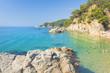 Lloret de Mar, Costa Brava, Spain - august 23, 2018: Cala Sa Boadella platja beach wit tourists on sunny clear summer day