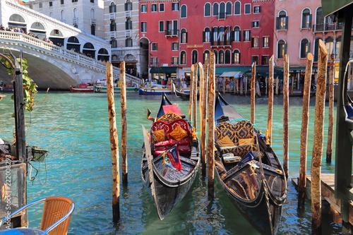 Venice, Italy-20 October, 2017: Luxury Gondola waiting for tourists near Rialto Bridge