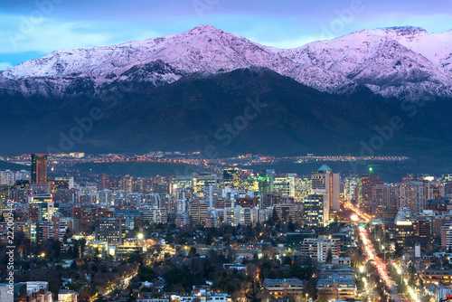 View of residential and office buildings at the wealthy district of Las Condes in Santiago de Chile with Los Andes Mountain Range in the back.