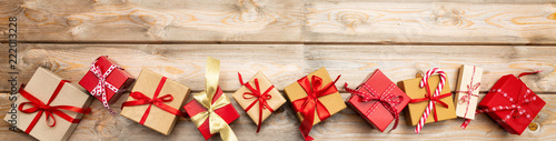 Christmas gift boxes on wooden background, banner, copy space, top view Wallpaper Mural