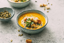 Pumpkin Soup In A Bowl With Croutons And Pumpkin Seeds. Autumn Food.