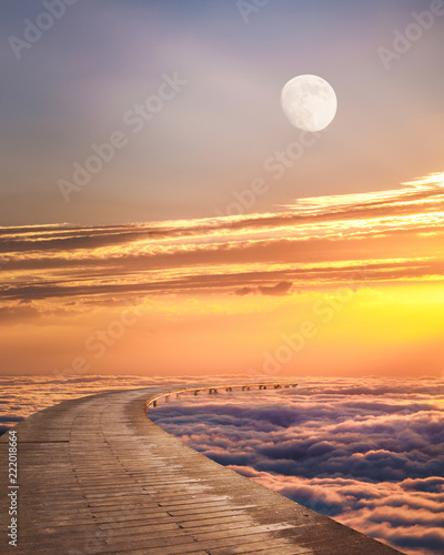 Fotobehang Diepbruine Beautiful fantasy landscape above the clouds against sunset.