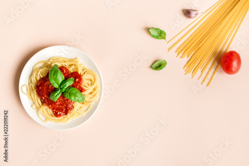Spaghetti pasta bolognese on pink