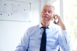Businessman talking on his mobile phone at his office