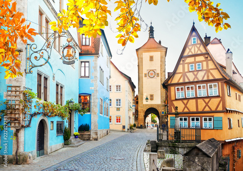 Fotografie, Tablou  half-timbered houses and city tower of Rothenburg ob der Tauber, Germany at fall