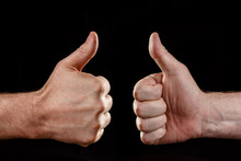 Two Hands Showing Approval, On A Black Background