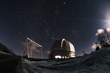 The view of the telescope BTA on a dark background of a starry sky. Arkhyz. Night astrophotography. Karachay-Cherkessia. SAO RAS.