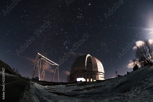 The view of the telescope BTA on a dark background of a starry sky Canvas Print