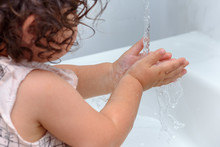 Child Washing Hand With Water....