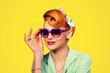 Leinwandbild Motiv pinup girl woman holding heart shaped sunglasses