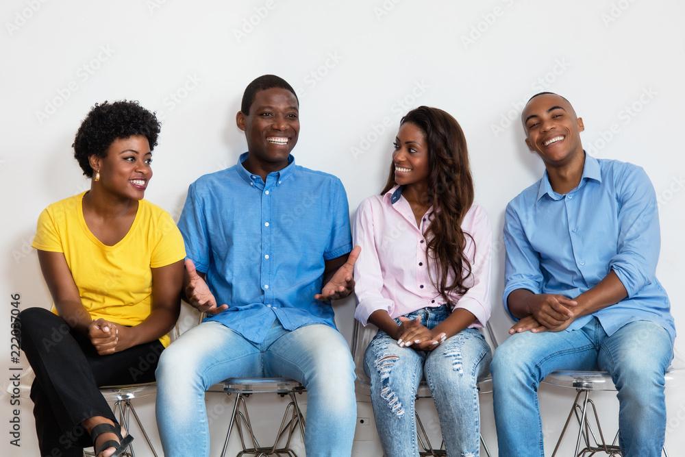 Fototapeta Talking african american group of people in waiting room