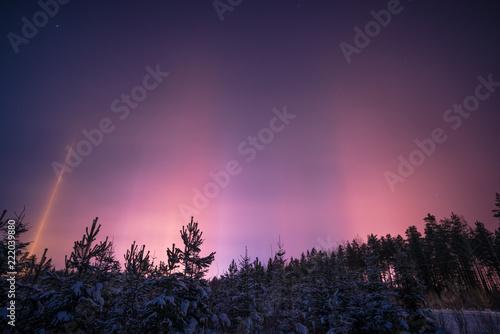 Foto op Aluminium Aubergine Beautiful phenomena of light pillars in winter.