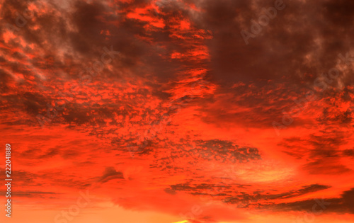 Foto op Canvas Baksteen Bright autumn sky with clouds at sunset