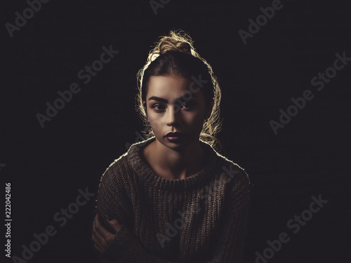 Classic shot of a Sexy Woman wearing a Sweater off the Shoulder