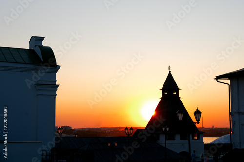 Fotografia  Evening landscape with the silhouette of an ancient fortress tower