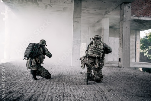 US soldiers stormed the building blowing up a smoke bomb Fototapeta