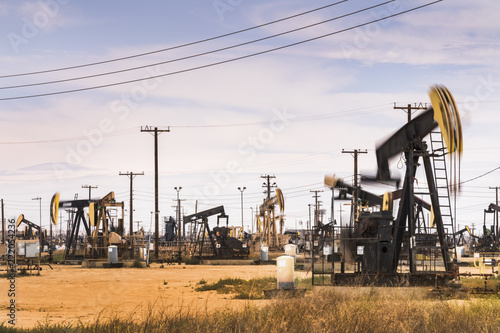 Fototapeta Crude oil pumps natural resources from the ground in California USA obraz