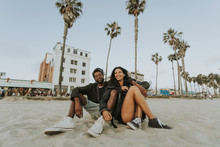 Couple Relaxing At Venice Beach