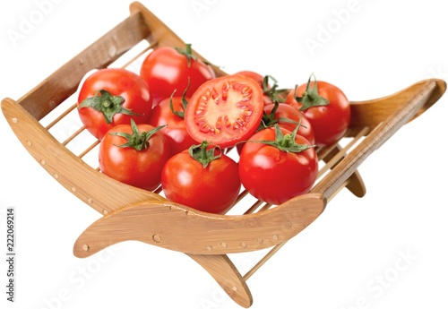 Fotografija  Tomatoes on a wooden holder