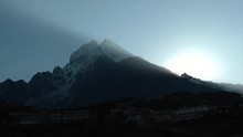 View Of A Sunrise Over A Peak ...