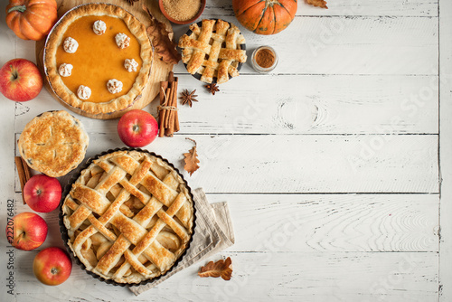 Fototapeta Thanksgiving pumpkin and apple various pies