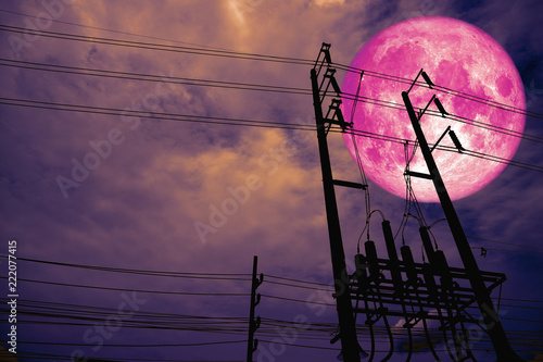 full pink moon back silhouette power electric line pillar in dark night sky