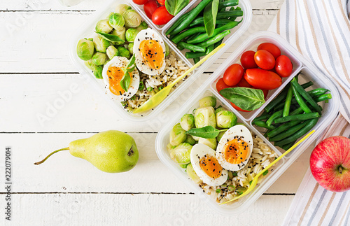 Assortiment Vegetarian meal prep containers with eggs, brussel sprouts, green beans and tomato. Dinner in lunch box. Top view. Flat lay