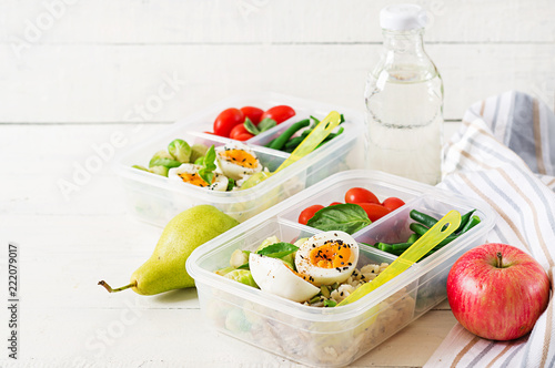 Keuken foto achterwand Assortiment Vegetarian meal prep containers with eggs, brussel sprouts, green beans and tomato. Dinner in lunch box
