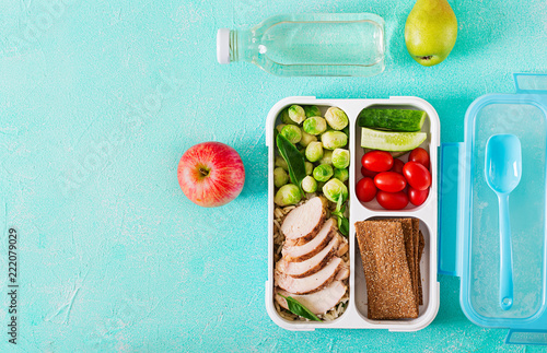 Fotobehang Assortiment Healthy green meal prep containers with chicken fillet, rice, brussels sprouts and vegetables overhead shot with copy space. Dinner in lunch box. Top view. Flat lay