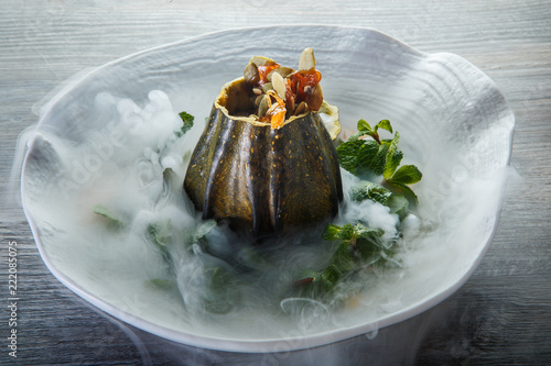 Fotografie, Obraz  delicious dessert served in pumpkin decorated with mint and smoke