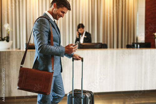 Businessman arriving at hotel lobby