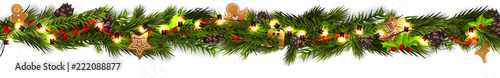 Fotografia  Christmas border (Weihnachten Girlande) with fir branches, pine cones, holly, and string lights