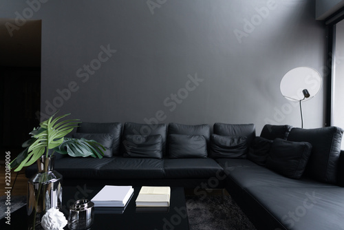 Cozy black leather sofa corner in the living room with gray ...