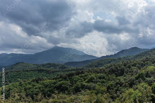 Fotobehang Landschap Storm cloudscape on a green mountain landscape