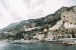 Amalfi coast in Italy, the most beautiful city. Streets and old architecture, narrow passages, shops and cafes. View from the sea and above