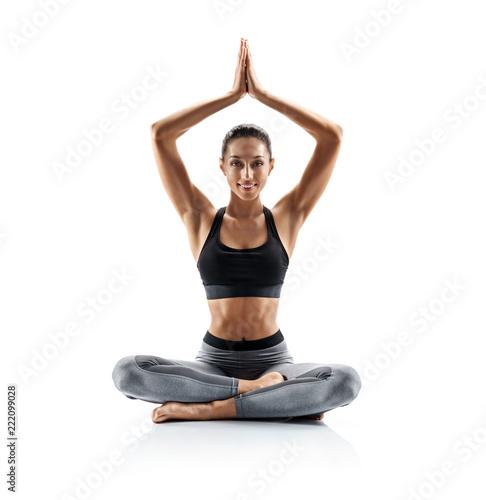 Photo Young girl practice balance asanas isolated on white background