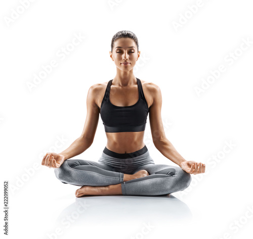Obraz Sporty young woman doing yoga practice isolated on white background. Concept of healthy life and natural balance between body and mental development. Full length - fototapety do salonu