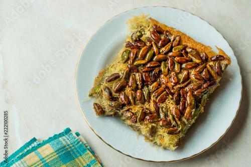 Fototapeta Turkish Dessert Kadayif with Pistachios served with Plate Portion obraz