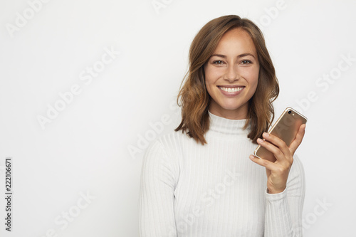 portrait of young beautyful woman on the phone looks in camera