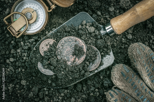 Fotografie, Obraz Russian empire ancient coins on the shovel and compass