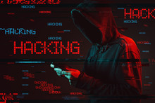 Computer Hacking Concept With Faceless Hooded Male Person