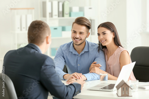 Real estate agent working with clients in office Wallpaper Mural