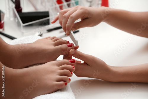 Deurstickers Pedicure Young woman getting professional pedicure in beauty salon, closeup
