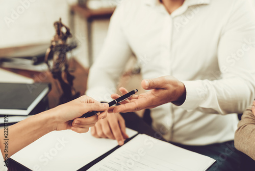 Husband and Wife Signing Documents with Lawyer. Fototapet
