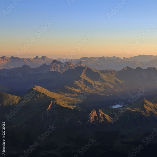 Summer sunrise in the Swiss Alps. View from Glacier 3000, Switzerland.