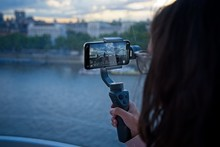 Girl Records Video With Her Mobile Phone On A Gimbal In London
