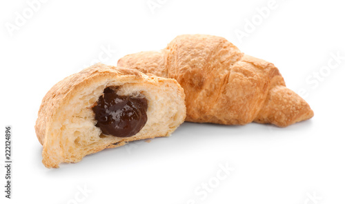 Tasty croissants with jam on white background