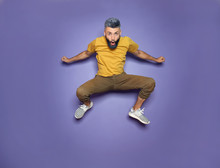 Active Jumping Man On Color Background