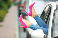 Young Woman With Slim Legs In High Heels Relaxing In Car